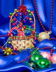 Wicker basket with Christmas decorations and gift