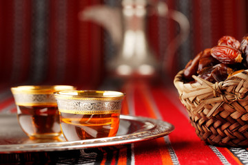 Iconic Abrian fabric tea and dates symbolise Arabian hospitality