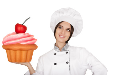 Woman Pastry Chef Holding Huge Cupcake