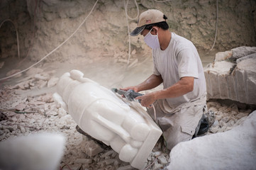Sculpting a marble elephant