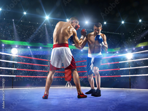 Two professionl boxers are fighting on arena - 74437650