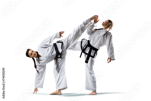Foto op Canvas Vechtsport Two isolated professional female karate fighters are fighting