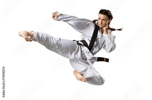 Foto op Canvas Vechtsport Professional female karate fighter isolated on white