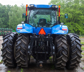 Rear view of the new blue tractor
