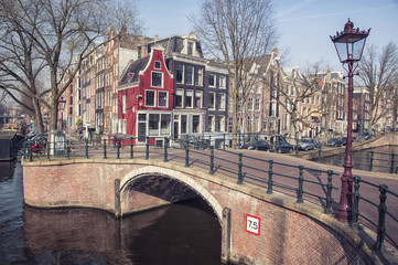 Canals of Amsterdam, Netherlands. Bridge at the city with houses
