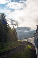 Passenger train going in the Carpathian Mountains
