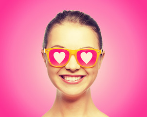 smiling teenage girl in pink sunglasses