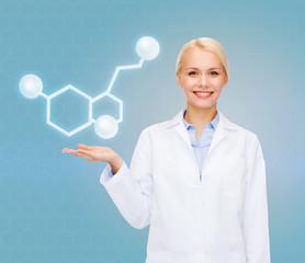smiling female doctor pointing to molecule