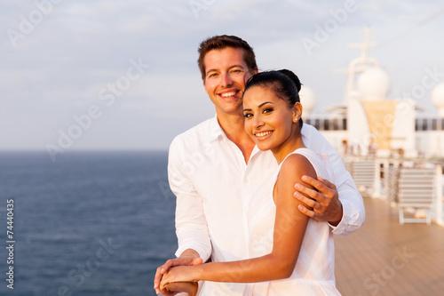 Leinwanddruck Bild young couple at sunset on a cruise