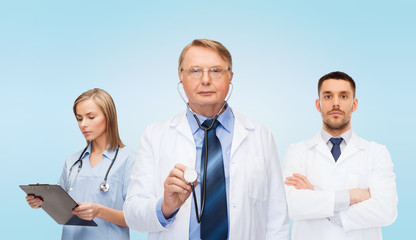 group of doctors with clipboard and stethoscopes