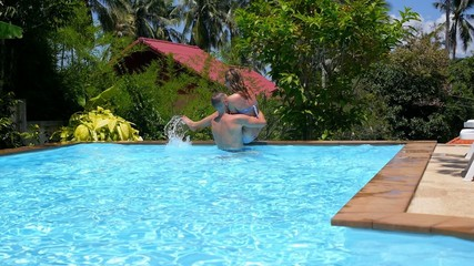 Healthy Lifestyle: Couple Having Fun at Swimming Pool.