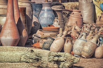 Dusty Clay pots stuck together at the village market in Morocco