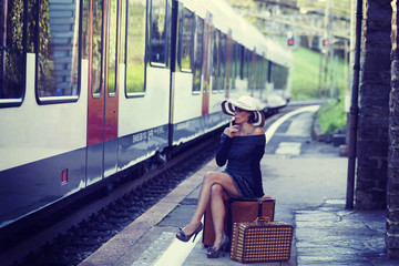 Woman waiting for the train at the station