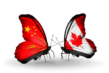 Two butterflies with flags China and Canada