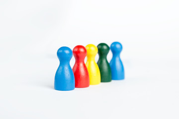Diversity concept with colorful game figurines in line