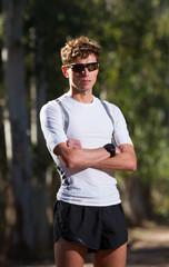 Runner man standing. Looking at camera