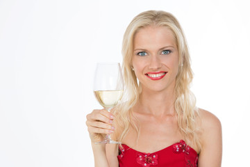 smiling nordic girl holding a glass of white wine