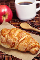 Croissant, coffee and apple