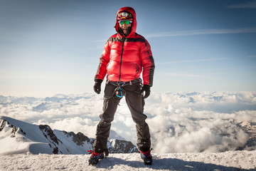 Climber on the summit of Mont Blanc