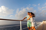 married couple standing on cruise deck