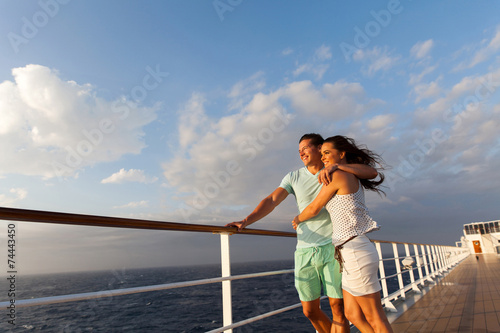 married couple standing on cruise deck - 74443450