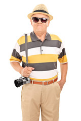 Vertical shot of a mature tourist with sunglasses