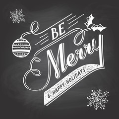 Hand-lettering Christmas greeting label on chalkboard