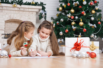 Two little girls writes letter to Santa