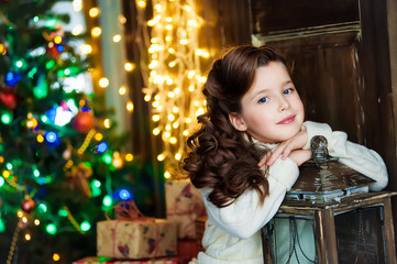 Portrait of the girl near christmas tree