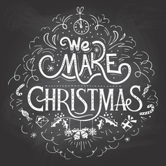 We make Christmas. Hand-lettering label on blackboard with chalk
