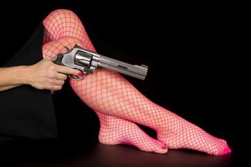 woman legs in pink fishnet pistol point