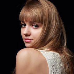 Beautiful teen girl with long blond hair. Closeup portrait
