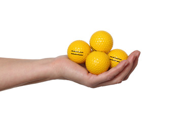 Yellow golf balls in hand isolated on white background