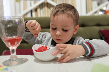 Child eating fruit ice cream