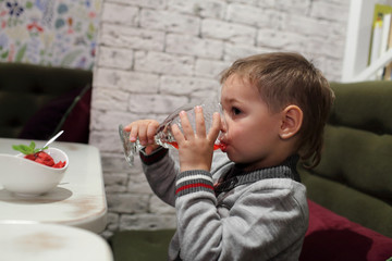 Kid drinking juice