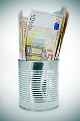 euro bills in a can