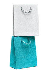 blue and silver gift bags on white background
