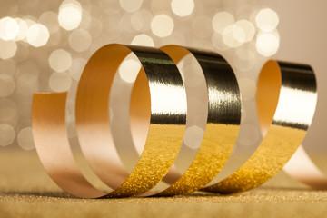 Golden ribbon on shiny background