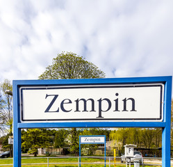old road sign Zempin at the train station