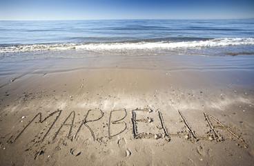 arena en la playa con agua  del mar y  Marbella en la arena