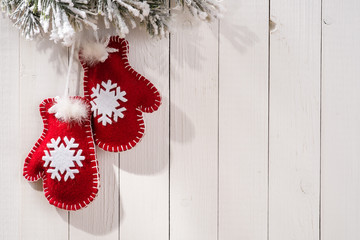 Christmas decoration with fir branches in the shape of mittens o