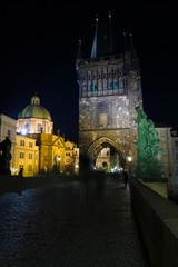 Prague. Tower on the Charles Bridge in the night illumination.
