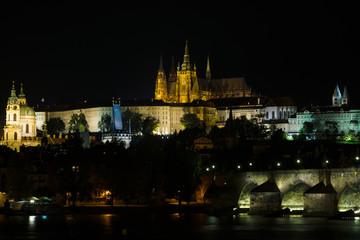 Prague Castle and the Charles Bridge at night illumination.