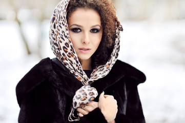 Young beautiful woman with long curly hairs - outdoor fashion po