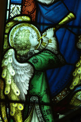 Angel making music on a trumpet