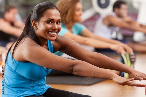 Tuinposter Gymnastiek Young Indian woman in a gym