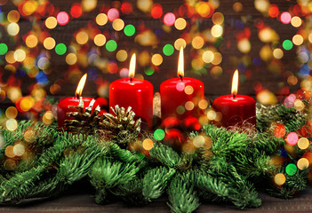 advent decoration with burning candles and colorful lights