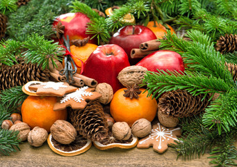 Apples, mandarin fruits, walnuts, cookies and spices