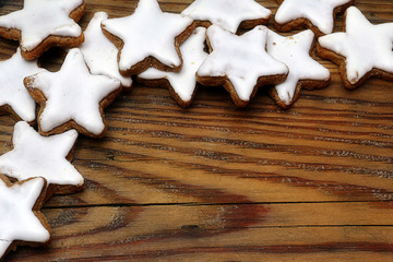 Christmas cookies, cinnamon stars on wood, corner background