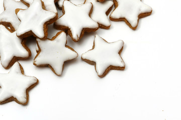 Christmas cookies, cinnamon stars, corner background on white
